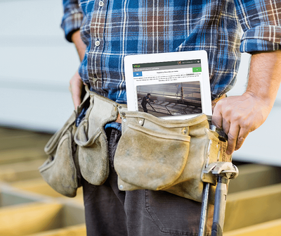 construction worker with training on ipad in the field